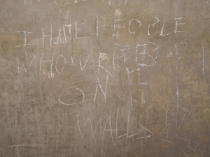Recent graffiti 'I hate people who write on walls' located on Corridor 2 of the Bottom Floor.